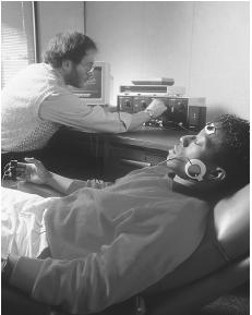 A patient undergoes biofeedback monitoring for stress. (Photo by Will and Deni McIntyre. Photo Researchers, Inc. Reproduced by permission.)