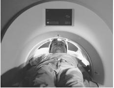 Patient lying on mobile table, entering a CT (computed tomography or CAT) scanner. (Volker Steger/Science Photo Library, Science Source/Photo Researchers, Inc. Reproduced by permission.)
