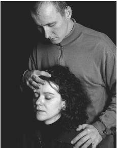 Woman undergoing therapeutic touch. In this form of healing, the therapist channels healing energy into the patient in order to cure the imbalances that cause physical or mental illness. (Cordelia Molloy/Science Photo Library. Photo Researchers, Inc. Reproduced by permission.)