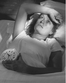 People with insomnia do not get enough restorative sleep, and often have daytime symptoms such as daytime sleepiness, fatigue, and decreased mental clarity. (Photo by David Pollack. Corbis Stock Market. Reproduced by permission.)