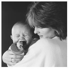 Care for a newborn can be overwhelming, and some women experience postpartum depression shortly after birth. (Layne Kennedy/CORBIS. Photo reproduced by permission.)